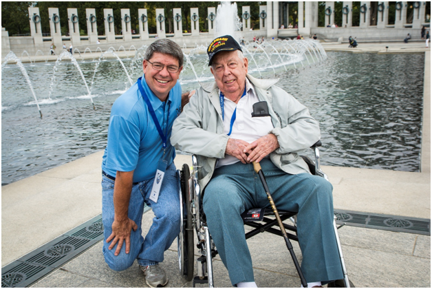 At the WWII memorial with Robert Poe, WWII Veteran. It was my honor to be his Guardian.